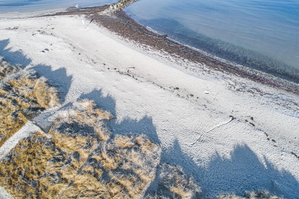 Landschaftsfotografie mit der Drohne von einer Mole an der Ostsee am Strand in Heidkate